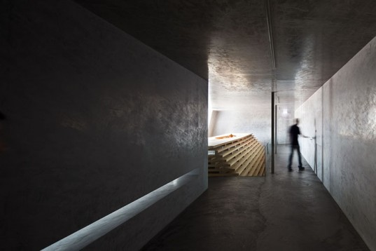 chapel features slatted walls for inspiring light and storage orta